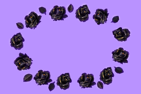 Background ornament made on black lilac background; oval shape, isolated; copy space for any text. Standard-Bild