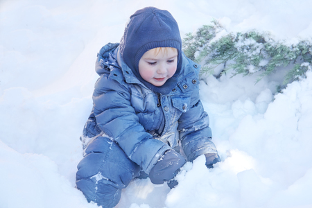 Snowing, laughing. Healthy childhood. Outdoors, copy space, close up portrait.