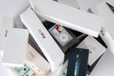 Rostov-on-Don, Rostov region / Russia - July, 2020: Many white and black cardboard boxes with Apple productions - Iwatch, iPhone, iPad and iPod on empty background. Minimalistic style, copy space. Editorial