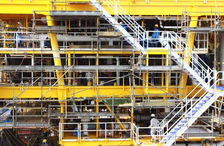 work worker workforce world: construction worker on a scaffold