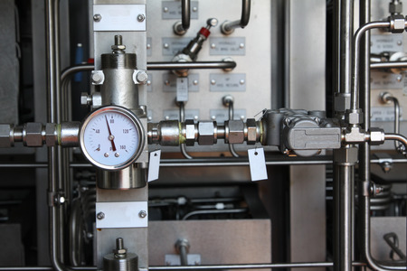 Pressure gauge for measuring pressure in the system, Oil and gas process used pressure gauge to monitor pressure condition inside the system Banco de Imagens - 42721433