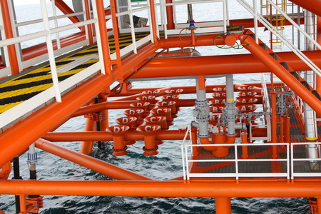 industry: Oil and Gas Producing Slots at Offshore Platform, Oil and Gas Industry. Well head slot on the platform or rig. Production and Explorer industry.