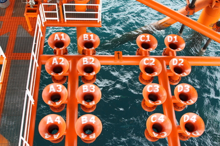 well head: Oil and Gas Producing Slots at Offshore Platform, Oil and Gas Industry. Well head slot on the platform or rig. Production and Explorer industry.