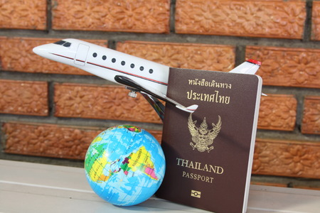 travel concept, passport model plane and the globe. Banco de Imagens