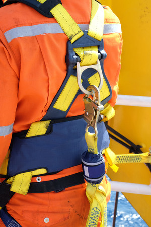 construction site worker at offshore with safety harness.