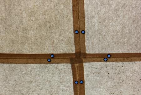 tarpaulin: The sky through the buttonhole of a tarpaulin