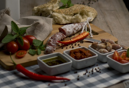 dry sausage: Dry sausage on an cutting board Stock Photo