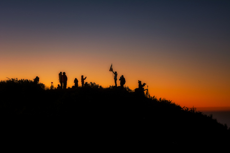 Silhouette A group of people stands on a mountains at the sunrise  On the top Doi Luang Chiang Dao Thailand
