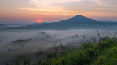 Amazing beautiful misty morning sunrise and road in mountain at Khao-kho Phetchabun,Thailand Stock Photo