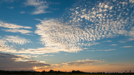 Beautiful sunset sky and clouds with rays of light shining clouds and sky