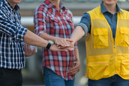 Male and female engineers. Hands of collaboration. teamwork concept Stock Photo