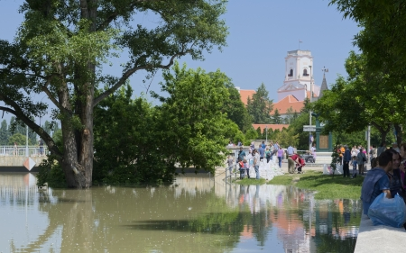 People Watching Flooding River Raba in Gyor, Hungary