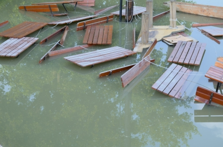 misadventure: Flooded Tables and Benches Lashed by a Rope Stock Photo