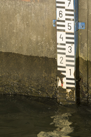 depth measurement: Dirty Water Level Scale on the Wall Close-up