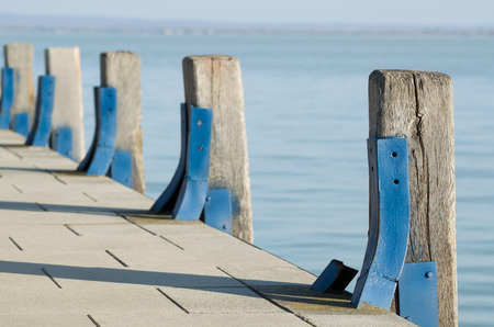 bracing: Pier Wood Piles with Blue Steel Bracing Stock Photo