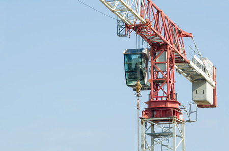 solid wire: White and Red Tower Crane Closeup with Solid Blue Sky
