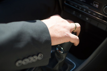gearstick: Driving Grooms Hand on Car Shift Knob Closeup