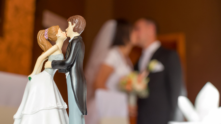 topper: Wedding Kiss Composition of a Wedding Figurine and Bride Groom Pair Stock Photo