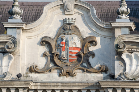 city coat of arms: Coat of Arms of the City of Gyor on the Facade of the Town Hall