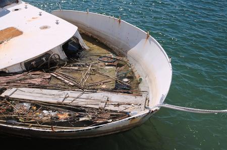 debris: Moored Ship Sunken at Harbor Full of Debris Closeup