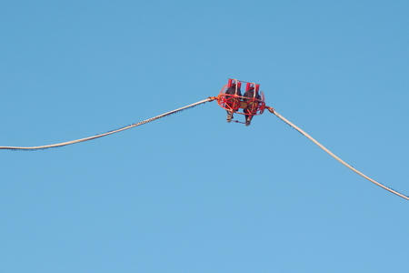 Theme Park Catapult Slingshot with Clear Blue Sky Stock Photo