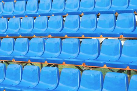 Empty Blue Plastic Outdoor Stadium Seats Closeup