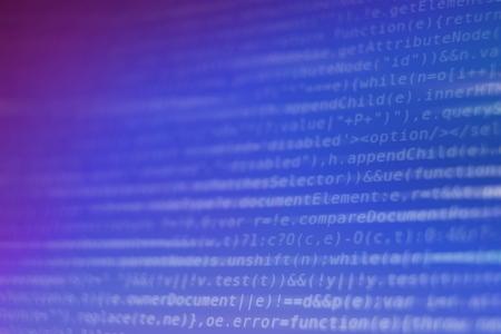 White Program Source Code Segment on Blue and Purple Screen Closeup