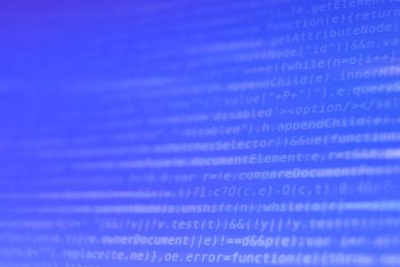 White Program Source Code Segment on Blue Screen Closeup