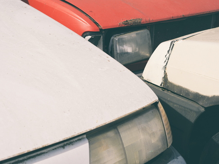 Car Junkyard White and Red Cars Front Abstract Closeup