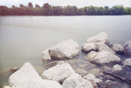 Long Exposure Danube Landscape with Tree Line and White Rocks