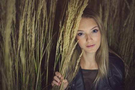 Teen Girl Night Portrait in Long Grass