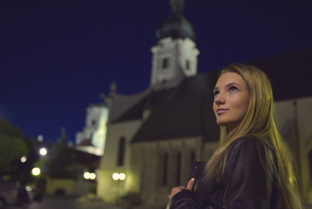 Teen Girl Night Portrait with Church Tower Stock Photo