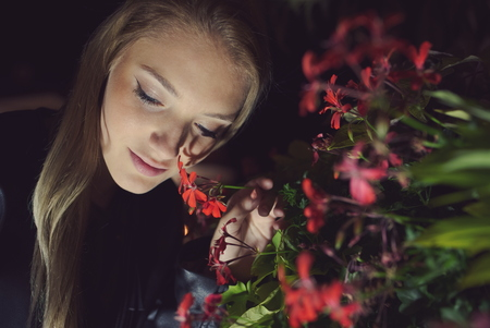 Teen Girl Night Portrait with Red Flowers