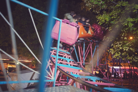 Fast Moving Roller Coaster at Town Fair Stock Photo