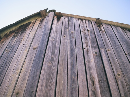 Wooden Shack Roof with Blue Sky Closeup