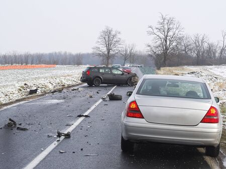 Damaged Cars and Debris on the Wet Road on a Winter Day