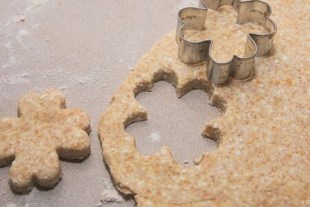 Four-leaf Clover Shaped Cutting Form on Flat Cottage Cheese Dough