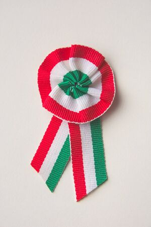 Red White Green Hungarian Cockade on White Background Closeup Foto de archivo