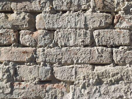 Old Weathered Rough Grey Brick Wall Closeup Фото со стока