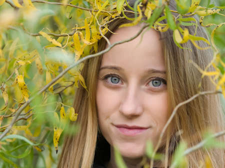 Portrait of a Young Beautiful Blonde Woman with Willow Leaves