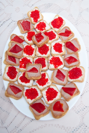 the oblong: Red caviar sandwiches on white oblong plate Stock Photo