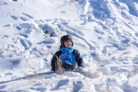 rejoice: Little boy playing in the snow. Doth sing and rejoice Stock Photo
