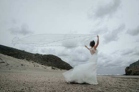The bridal beautifully veils evolving in the wind. LLooking at sea. Stock Photo - 118398678