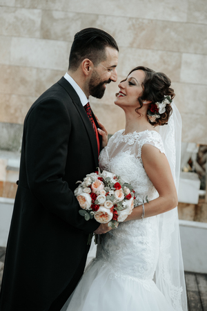 Gorgeous wedding couple. Pretty bride and stylish groom.