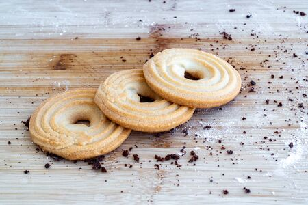 Homemade pastry. Bagel shortbread cookies on a wooden table. Shortbread Cookies bagel. Tasty Danish butter cookies. Bake at home.