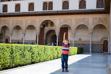 A child walks in the Alhambra.