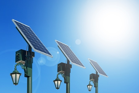 electrical panel: Solar photovoltaic powered lamp posts on the blue skies with sun Stock Photo