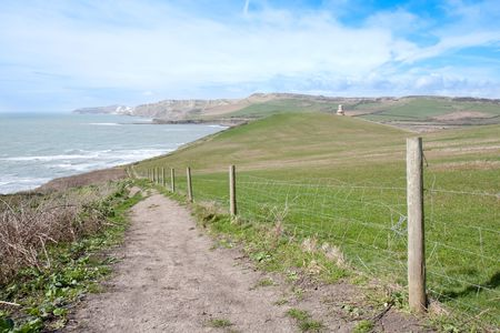 kimmeridge bay: A coastal footpath on a sunny spring afternoon in Dorset, UK.