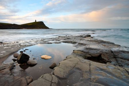 kimmeridge bay: A rock pool at low tide in a rock on the beach of Kimmeridge Bay in Dorset, UK. Stock Photo