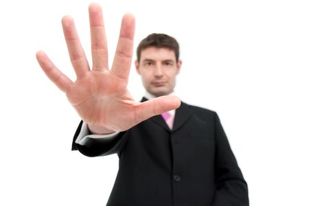 A mid thirties businessman in a black suit holding up five fingers.  Differential focus on the hand. photo